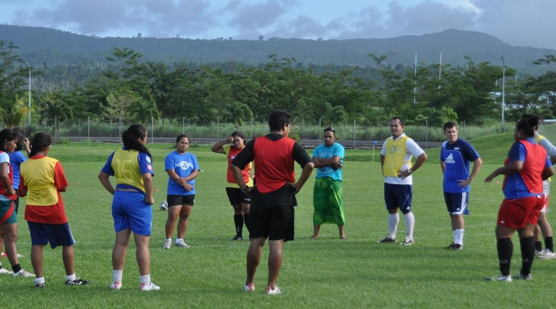 A group prepares for a practice during volunteer rugby coaching  experience in Samoa.